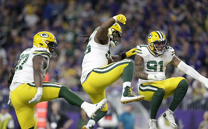 Green Bay Packers' Kenny Clark, left, Za'Darius Smith and Preston Smith, right, celebrate after a sack during  a game against the Minnesota Vikings, Monday, Dec. 23, 2019, in Minneapolis. (Andy Clayton-King/AP)