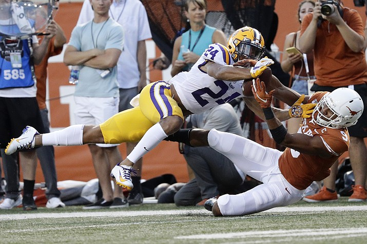 In this Sept. 7, 2019, photo, LSU cornerback Derek Stingley Jr., left, breaks up a pass intended for Texas wide receiver Collin Johnson during the first half of a game, in Austin, Texas. Stingley was selected as newcomer of the year on The Associated Press All-Southeastern Conference football team, Monday, Dec. 9, 2019. (Eric Gay/AP, file)