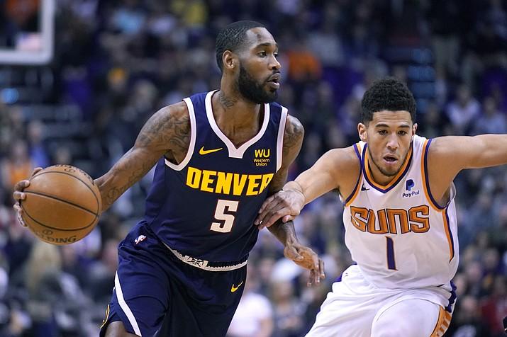 Denver Nuggets guard Will Barton (5) drives past Phoenix Suns guard Devin Booker in the first half of a game, Monday, Dec. 23, 2019, in Phoenix. (Rick Scuteri/AP)