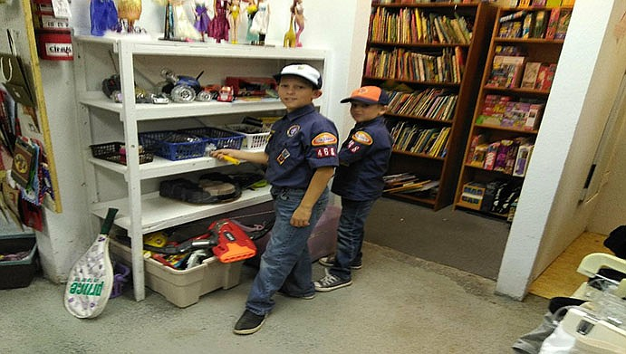 Cub Scouts Malakai Palubicki, 9, and Elijah Palubicki, 7, recently volunteered their time cleaning and making lunches for homeless persons at St. Vincent de Paul in Kingman.