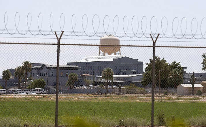 "In this 2014 file photo, a fence surrounds the state prison in Florence, Arizona. An organization that has been seeking prison reform for years has now decided to ask voters to do what lawmakers and the governor so far will not: revamp the so-called ""truth in sentencing"" laws. (AP photo, file)"