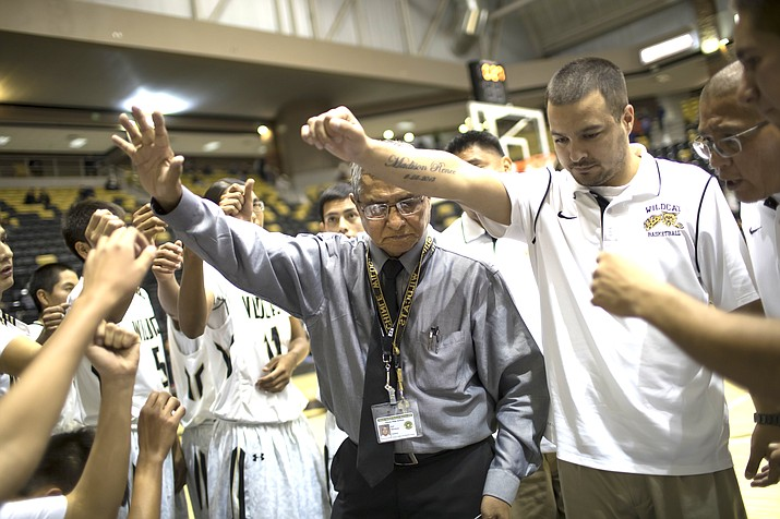 Game time. From left: Chinle Basketball Coach Raul Mendoza and assistant coaches Beau Natay and Ned Curley prepare for a 2017-2018 game. (Photo by Nathaniel Brooks)