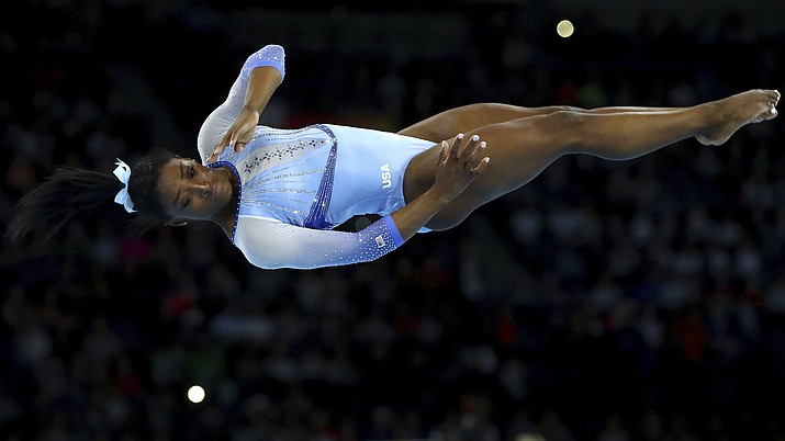 In this Oct. 5, 2019, photo, Simone Biles, of the United States, performs on the floor during qualifying sessions for the Gymnastics World Championships in Stuttgart, Germany. (Matthias Schrader/AP)