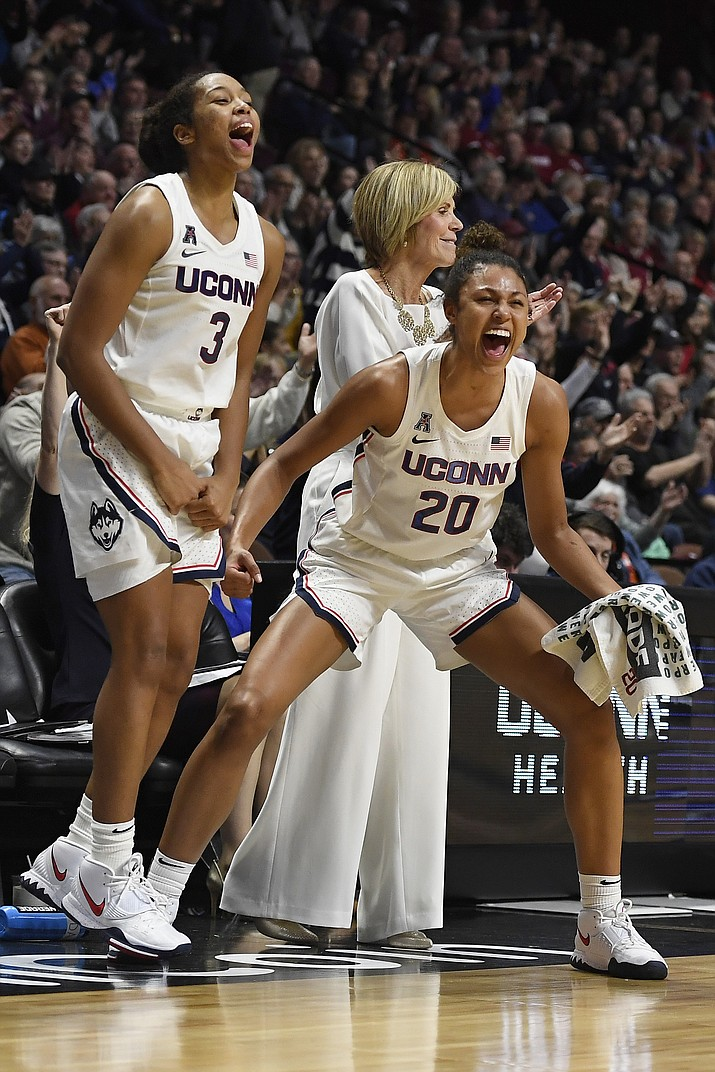 Connecticut's Megan Walker, left, and Olivia Nelson-Ododa celebrate in the second half of a game against Oklahoma, Sunday, Dec. 22, 2019, in Uncasville, Conn. (Jessica Hill/AP)