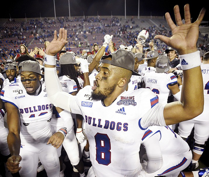 Louisiana Tech's J'Mar Smith celebrates with teammates after winning the NCAA college football Independence Bowl against Miami, Thursday, Dec. 26, 2019, at Independence Stadium in Shreveport, La. (Henriette Wildsmith/The Shreveport Times via AP)