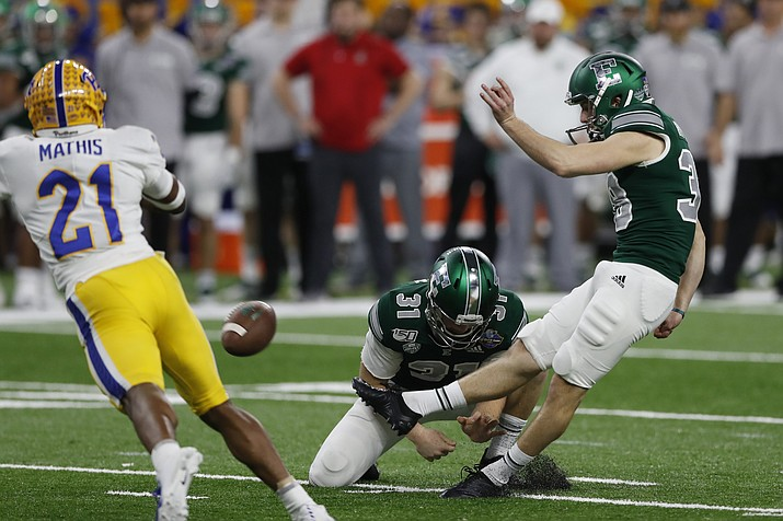 Pittsburgh defensive back Damarri Mathis (21) attempts to block a field goal by Eastern Michigan placekicker Chad Ryland, right, during the first half of the Quick Lane Bowl NCAA college football game, Thursday, Dec. 26, 2019, in Detroit. (AP Photo/Carlos Osorio)