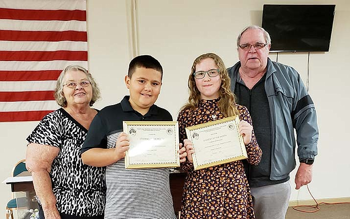 From the left are Jerome Elks Lodge No. 1361 Exalted Ruler Janet Leuer, Clarkdale-Jerome School December 2019 Students of the Month and sixth-graders Jordan Watson and Tasha Morgan-Andrus, and Lodge Youth Activities Co-Chair Ray Stock.