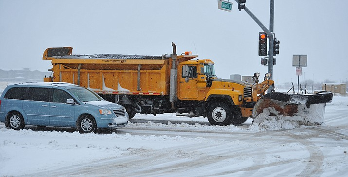 In this February 2019 file photo, Prescott Valley snowplows are seen on Glassford Hill Road as a winter storm strikes in Prescott Valley. (Courier file photo)
