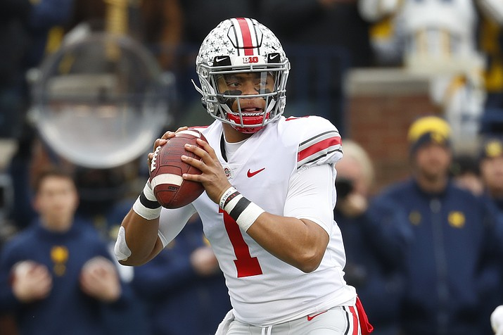 Ohio State QB Justin Fields throws against Michigan during the first half of a game in Ann Arbor, Mich., Saturday, Nov. 30, 2019. (Paul Sancya/AP)