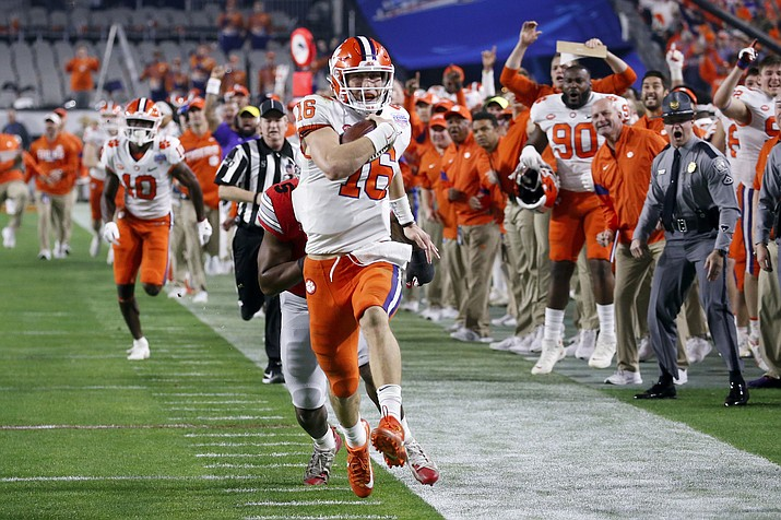 Clemson quarterback Trevor Lawrence runs for a touchdown against Ohio State during the first half of the Fiesta Bowl NCAA college football playoff semifinal Saturday, Dec. 28, 2019, in Glendale. (Ross D. Franklin/AP)