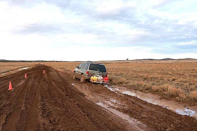 A vehicle belonging to a married elderly couple is mired in the mud near Ash Fork. The couple was found frozen to death about a mile from the vehicle Dec. 6. Police believe they tried to walk to their home after the vehicle got stuck in the snow. (YCSO/Courtesy photo)