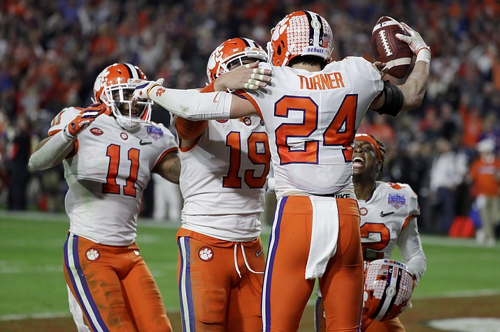 Clemson safety Nolan Turner (24) celebrates after his interception against Ohio State in the final minute of the Fiesta Bowl college football playoff semifinal Saturday, Dec. 28, 2019, in Glendale. (Rick Scuteri/AP)