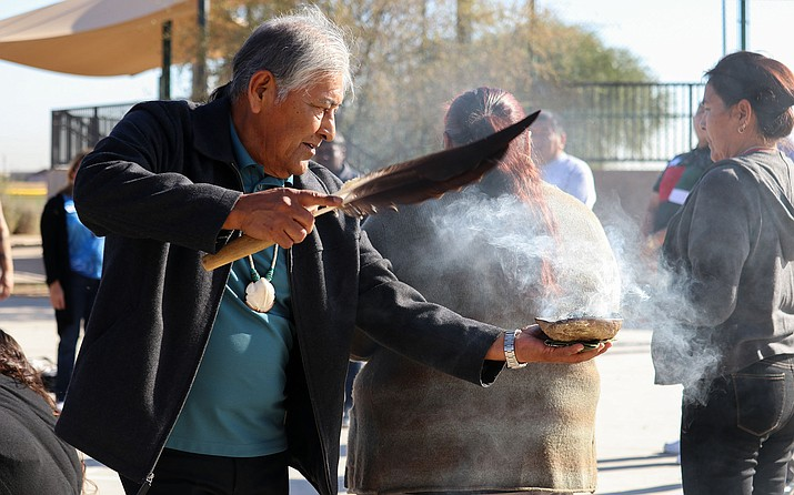 Barnaby Lewis participates in a smudging, in which smoke from a special plant is waved around individuals to cleanse the spirit. (Photo/Megan Marples, Cronkite News)