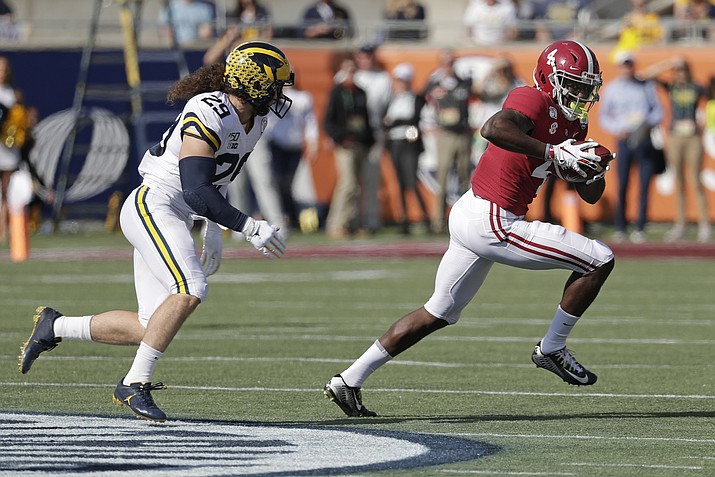 Alabama wide receiver Jerry Jeudy (4) runs after a reception past Michigan linebacker Jordan Glasgow (29) during the first half of the Citrus Bowl NCAA college football game, Wednesday, Jan. 1, 2020, in Orlando, Fla. (John Raoux/AP)
