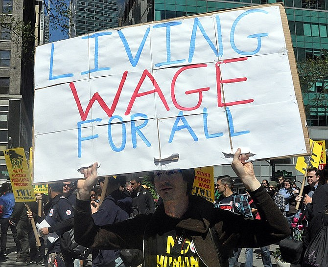 """Arizona's $12-an-hour minimum wage as of Jan. 1, 2020, is one of the highest in the country , but still well shy of the $15-an-hour """"living wage"""" that some advocates are pushing for, as in this 2013 file photo from New York. Business officials call mandated minimums counter-productive. (Photo by Michael Fleshman)"""