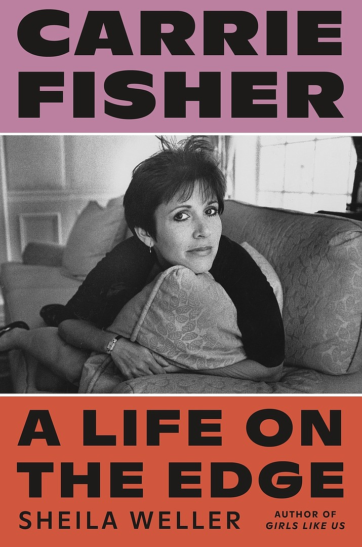 """This cover image released by Sarah Crichton Books shows """"Carrie Fisher: A Life on the Edge,"""" by Sheila Weller. (Sarah Crichton Books via AP)"""
