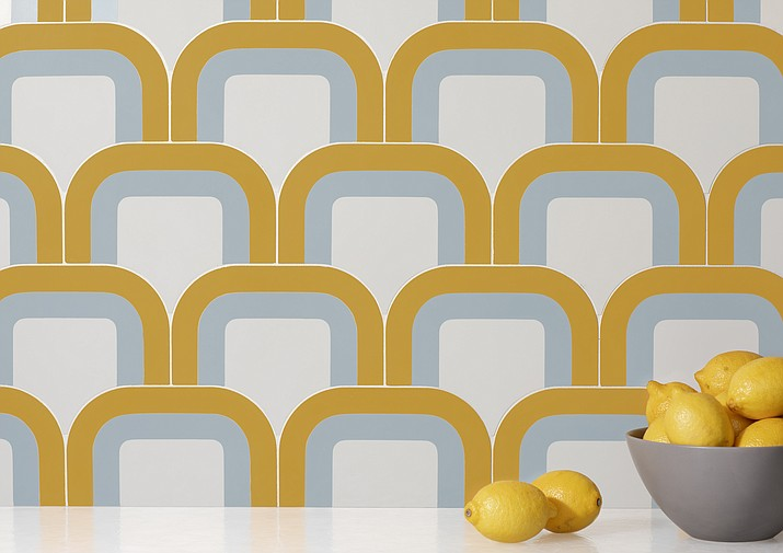 This undated photo provided by Walker Zanger shows tile by Australian designer Pietta Donovan, who has created a hip collection of cement tile inspired by the kaleidoscopic shapes, curvy profiles and distinct colorways of '70s wallpaper. (Walker Zanger via AP)