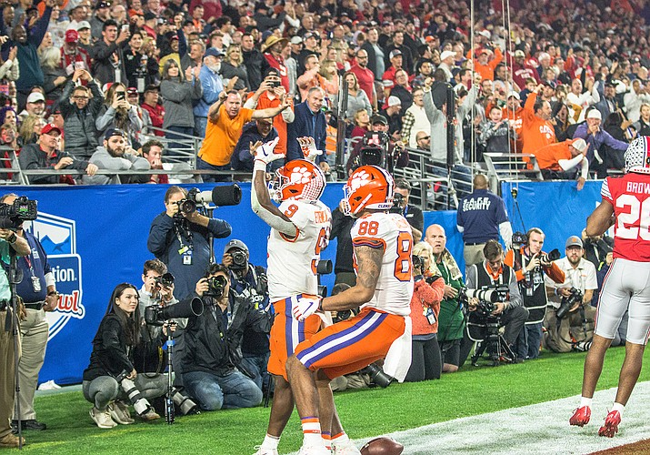 Clemson junior running back Travis Etienne celebrates after his 53-yard receiving touchdown in the third quarter to give Clemson its first lead in the Fiesta Bowl in Glendale, Arizona, on Dec. 28, 2019. (Photo by Nathan Hiatt/Cronkite News)