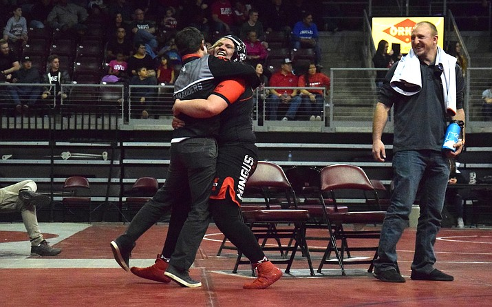 Mingus Union's Danni Schulz hugs Marauder head coach Klint McKean after winning the first AIA girls state championship at 225 on Feb. 9 at Findlay Toyota Center. VVN/James Kelley