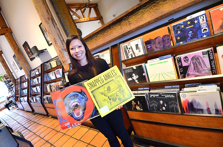 Jen Keenan, manager of Puscifer – The Store in Jerome, displays a Puscifer album with a colored vinyl album on the left and a traditional= album cover at her Jerome store. VVN/Vyto Starinskas