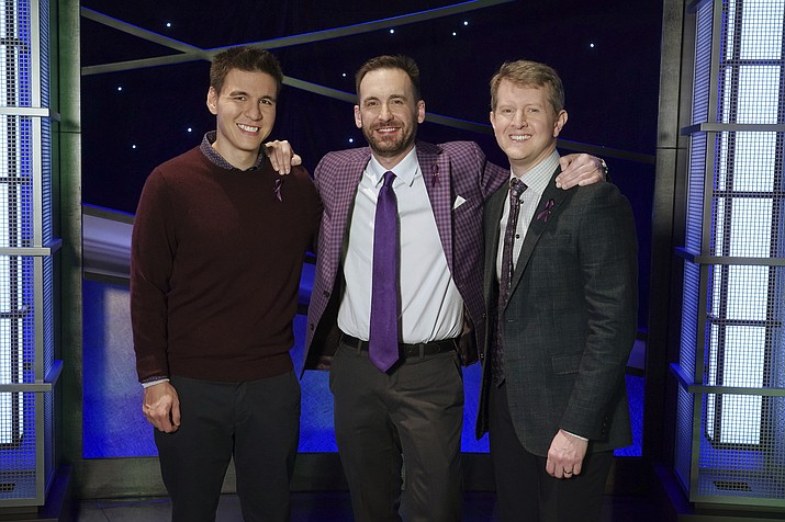 "In this image released by ABC, contestants, from left, James Holzhauer, Brad Rutter and Ken Jennings appear on the set of ""Jeopardy!"" in Los Angeles. The all-time top money winners; Rutter, Jennings and Holzhauer, will compete in a rare prime-time edition of the TV quiz show ""Jeopardy! The Greatest of All Time,"" which will air on consecutive nights beginning 8 p.m. EDT Tuesday. (Eric McCandless/ABC via AP)"