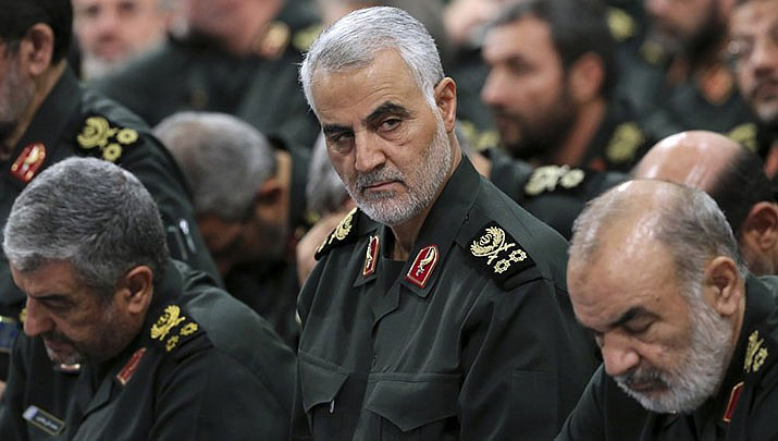 In this Sept. 18, 2016, file photo provided by an official website of the office of the Iranian supreme leader, Revolutionary Guard Gen. Qassem Soleimani, center, attends a meeting in Tehran, Iran. Iraqi TV and three Iraqi officials said Friday, Jan. 3, 2020, that Soleimani, the head of Iran's elite Quds Force, has been killed in an airstrike at Baghdad's international airport. (Office of the Iranian Supreme Leader photo)