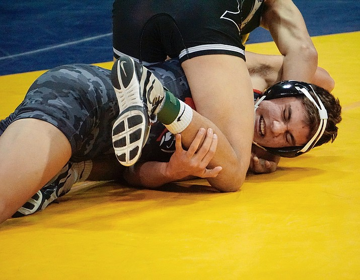 Bradshaw Mountain's Owen Alvarez tries to escape a submission during the third round of the championship 145-lbs. bracket at the Mile High Challenge wrestling tournament on Friday, Jan. 3, 2020, in Prescott Valley. (Aaron Valdez/Courier)