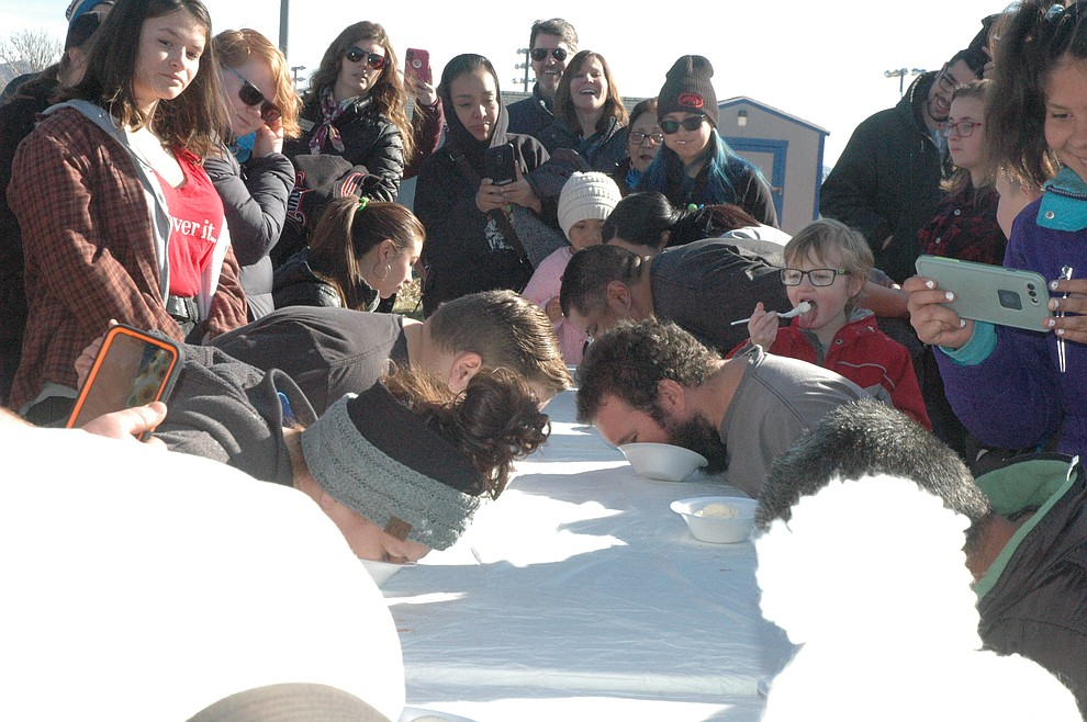 Adults compete in an ice cream eating contest during the 15th annual Polar Bear Splash at Mountain Valley Splash Saturday, Jan. 4, 2020. (Jason Wheeler/Courier)