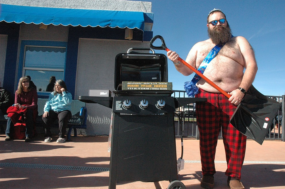 """Kellen """"The Beard"""" Hoskins became the newest Ice Princess after two years during the 15th annual Polar Bear Splash at Mountain Valley Splash Saturday, Jan. 4, 2020. (Jason Wheeler/Courier)"""