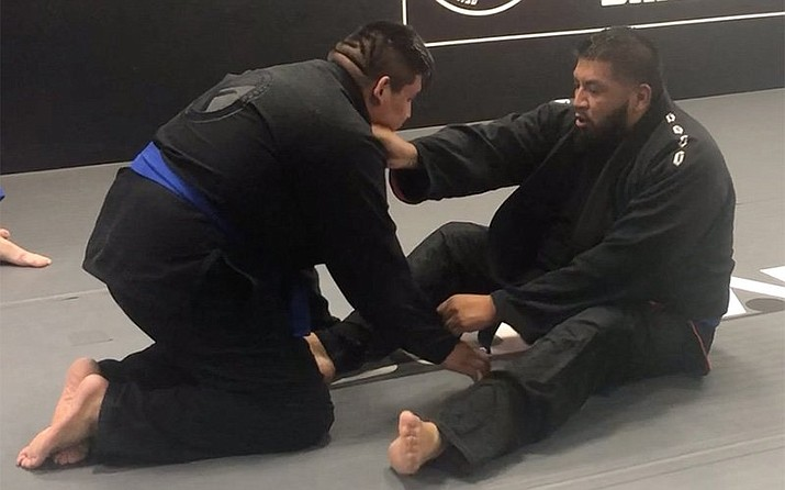 Salt River Pima-Maricopa Indian Community's fitness center and programs helped Alex Alejandre, right, lose 75 pounds in a year by incorporating such workouts as Brazilian jiu-jitsu. (Photo by Daniel Gatalica/Cronkite News)