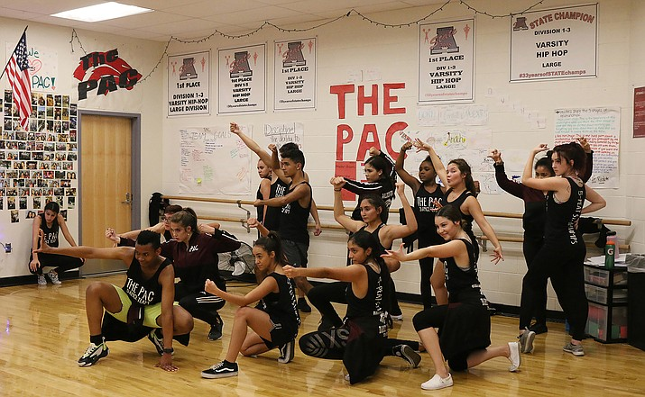 The PAC dance team at Walden Grove High School in Sahuarita practiced their Avengers performance. It first performed this dance during a homecoming show in September. (Photo by Cassidy McCauley/Cronkite News)