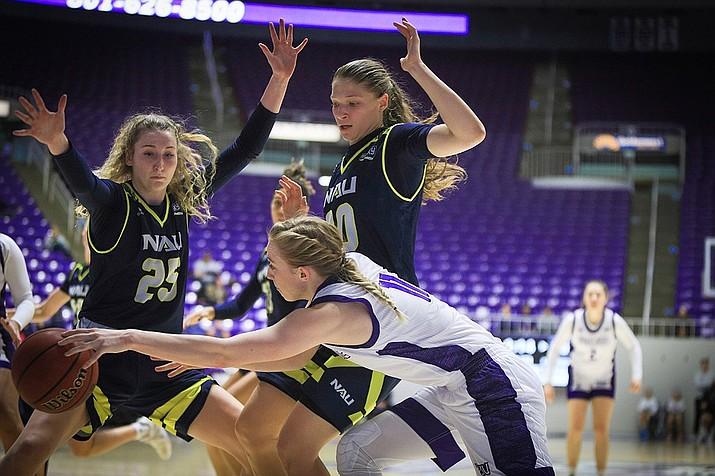 NAU forwards Brianna Lehew (25) and Nina Radford (30) play defense during a game against Weber State on Saturday, Jan. 4 , 2019, in Ogden, Utah. (Freddie Lacey, NAU Athletics/Courtesy)