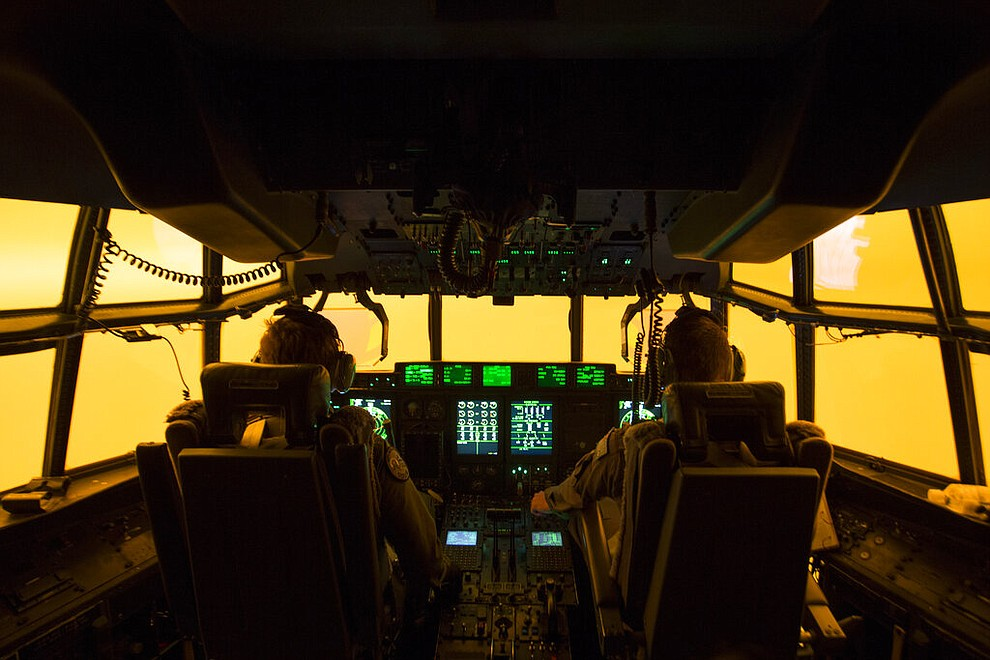 In this Sunday, Jan. 5, 2020, photo provided by Australian Department of Defence, the flight deck of a C-130J Hercules aircraft has a warm glow from wildfires, as they prepare to land at Merimbula airfield to deploy Fire and Rescue crews. The wildfires have so far scorched an area twice the size of the U.S. state of Maryland. (SGT Christopher Dickson/ADF via AP)