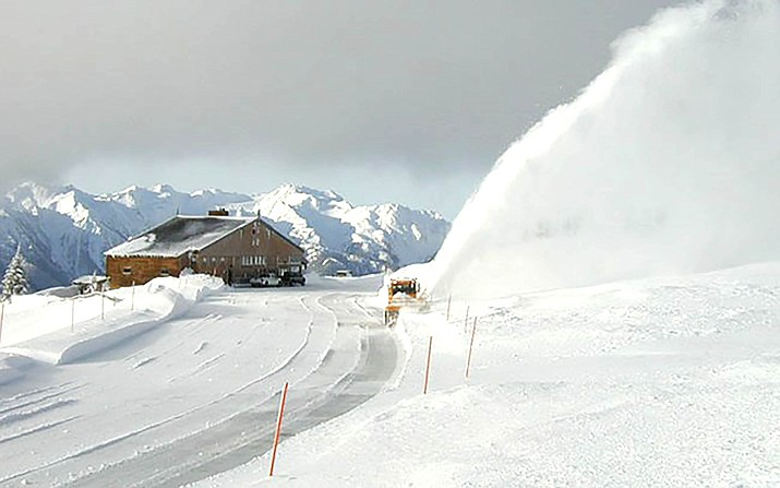 A snowblower clears the parking lot at Hurricane Ridge in winter. (Photo/NPS)