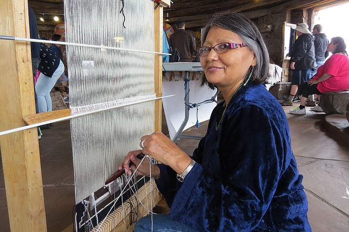 Navajo weaver Florence Riggs demonstrates her work during a cultural demonstration at Desert View Watchtower in Grand Canyon. (Photo/NPS)