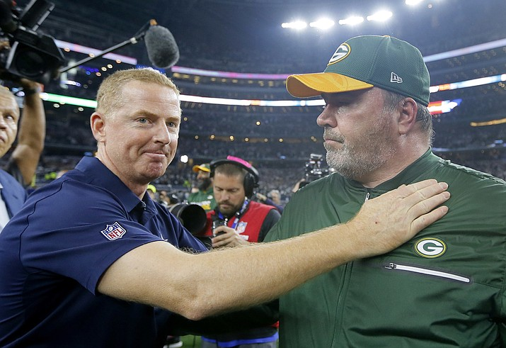 In this Jan. 15, 2017, file photo, Dallas Cowboys coach Jason Garrett, left, congratulates Green Bay Packers coach Mike McCarthy after their 34-31 win in an NFL divisional playoff football game in Arlington, Texas. The Dallas Cowboys didn't take long to settle on Mike McCarthy as their coach after waiting a week to announce they were moving on from Jason Garrett. McCarthy, who won a Super Bowl at the home of the Cowboys nine years ago as Green Bay's coach, has agreed to become the ninth coach in team history, a person with direct knowledge of the deal said Monday, Jan. 6, 2020.The person spoke to The Associated Press on condition of anonymity because the team hasn't announced the move. (Tony Gutierrez/AP, file)