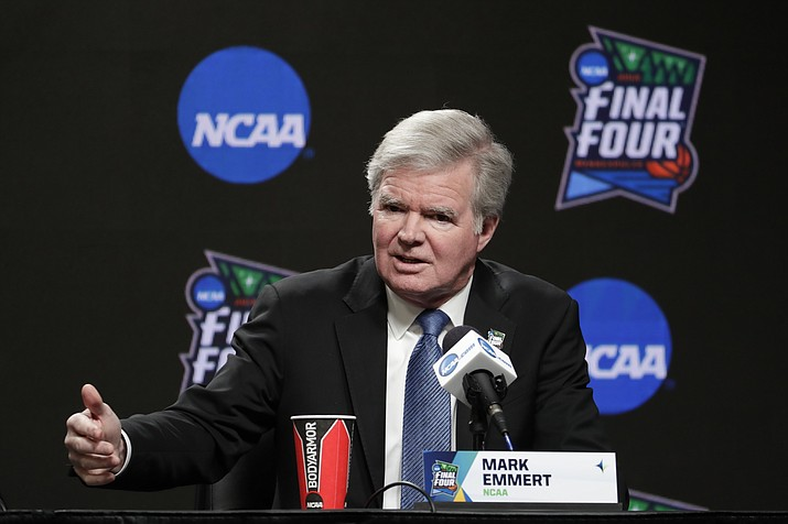 In this April 4, 2019, file photo, NCAA President Mark Emmert answers questions at a news conference at the Final Four college basketball tournament in Minneapolis. Emmert and other college sports leaders say they are concerned about allowing college athletes to enter the free market with no restrictions on how and by whom they can be paid for endorsements. (Matt York/AP, file)