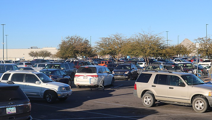 There is no shortage of activity in parking lots, and if motorists aren't careful, a fender bender or transfer of paint could be lying in wait. (Photo by Travis Rains/Kingman Miner)