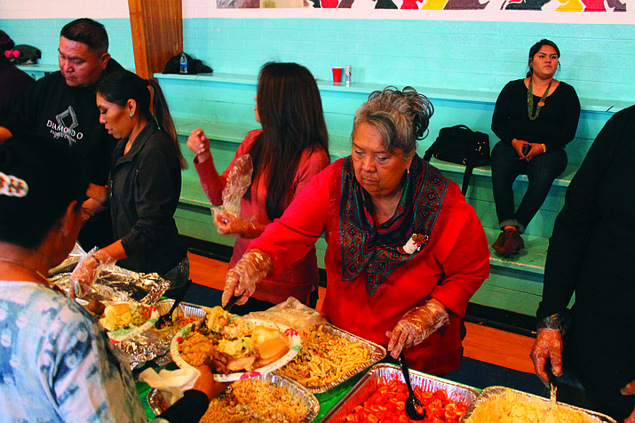 Volunteer Ivy Multine serves food to attendees at the Community Christmas Dinner Dec. 25, in Tuba City, Arizona.  (Photo/Joshua Lavar Butler)