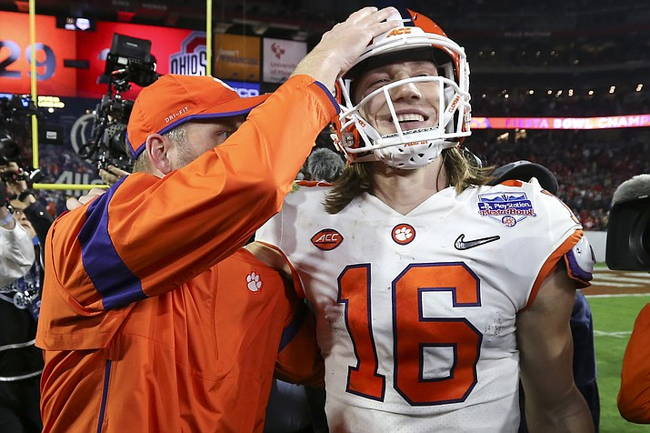 Clemson quarterback Trevor Lawrence (16) is congratulated after Clemson defeated Ohio State 29-23 in the Fiesta Bowl NCAA college football playoff semifinal Saturday, Dec. 28, 2019, in Glendale. (Ross D. Franklin/AP)
