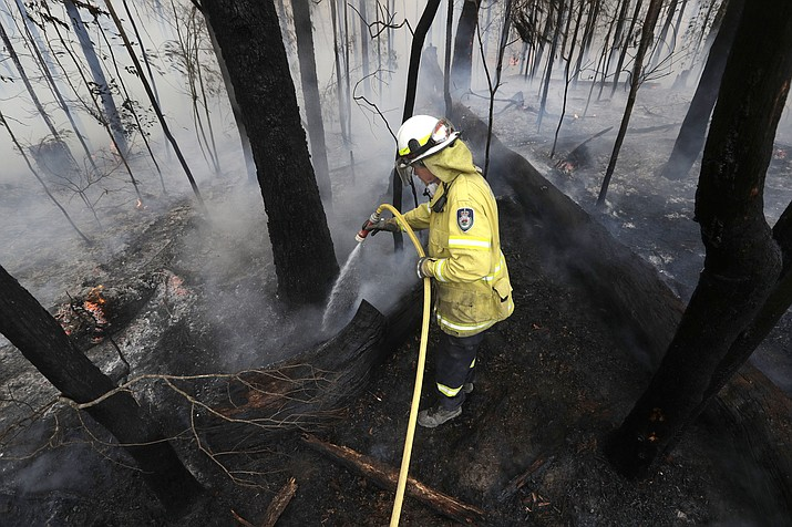 A firefighter manages a controlled burn near Tomerong, Australia Jan. 8 in an effort to contain a larger fire nearby. Around 2,300 firefighters in New South Wales state were making the most of relatively benign conditions by frantically consolidating containment lines around more than 110 blazes and patrolling for lightning strikes, state Rural Fire Service Commissioner Shane Fitzsimmons said. (AP Photo/Rick Rycroft)