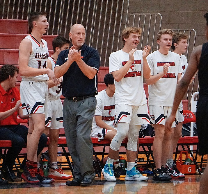 Bradshaw Mountain boys basketball head coach Blair Hillig and the team reserves celebrate on the sideline during a game against Buckeye on Tuesday, Dec. 10, 2019, in Prescott Valley. (Aaron Valdez/Courier, file)