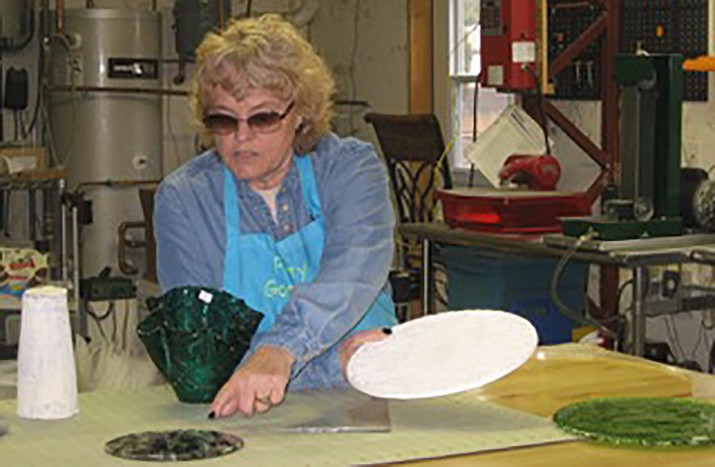 Patty Lindsey at work on one of her glass creations. (Patty Lindsey/Courtesy)