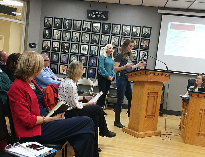 Taylor Hicks Elementary fourth grade teacher Roberta Runyan speaks to Prescott Unified Governing Board members during a school data presentation. Principal Kelsey Secor stands behind her. (Nanci Hutson/Courier)