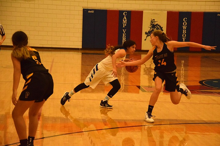 Camp Verde sophomore Addy Herrera-Caballero dribbles past an Eagle during the Cowboys' 64-41 win over Phoenix Country Day at home on Wednesday night. VVN/James Kelley