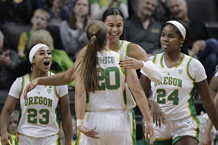 Oregon's Minyon Moore, Sabrina Ionescu, Satou Sabally and Ruthy Hebard, from left, celebrate a play during the third quarter of the team's game against Colorado in Eugene, Ore., Friday, Jan. 3, 2020. (Chris Pietsch/AP)