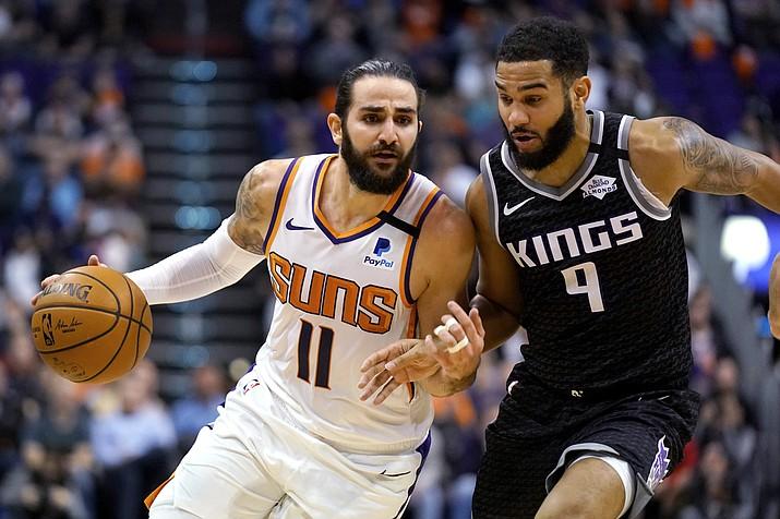 Phoenix Suns guard Ricky Rubio (11) drives against Sacramento Kings guard Cory Joseph during the second half in a game Tuesday, Jan. 7, 2020, in Phoenix. The Kings won 114-103. (Rick Scuteri/AP)