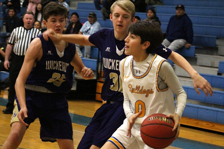 Kingman sophomore Garrett Stryker tallied 14 of the Bulldogs' 23 bench points Thursday in a 72-43 victory over Wickenburg. (Photo by Beau Bearden/Kingman Miner)