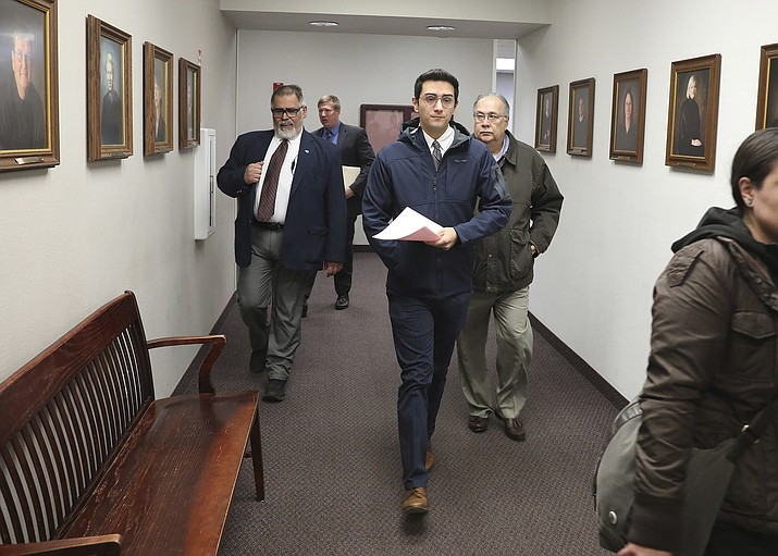 Steven Jones, center, leaves Coconino County Superior Court Thursday Jan. 9, 2020 in Flagstaff, Ariz. Jones, a former Northern Arizona University student pleaded guilty Thursday to manslaughter in the shooting death of a fellow student on campus, sparing him from a second trial and the potential for a much lengthier prison term. (Jake Bacon/Arizona Daily Sun via AP)