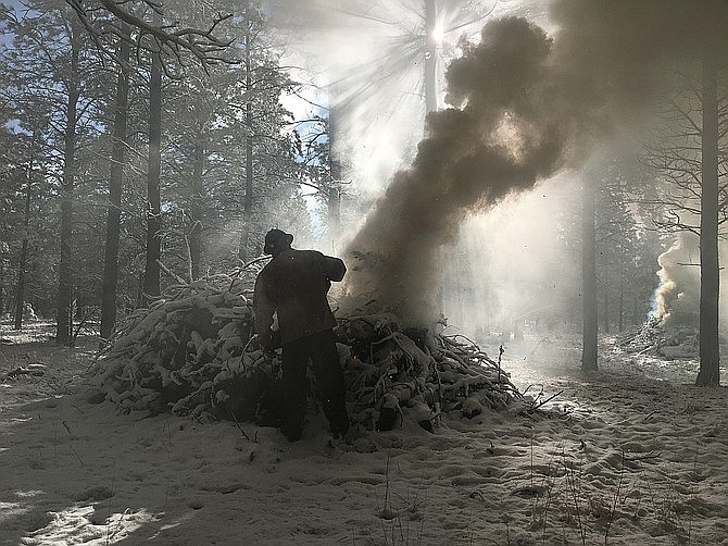 Piles of slash are the focus of many controlled burns, to clean up after brush work on the forest. (Courier file)